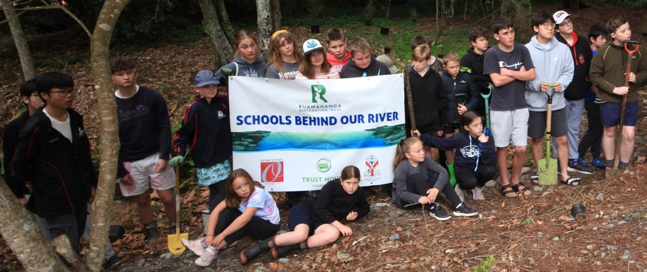 """Group of students at a """"Schools behind our river"""" planting day"""
